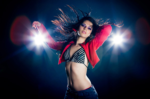 Female model standing in front of lights