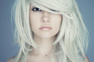Blonde model with hair swept in front of eyes